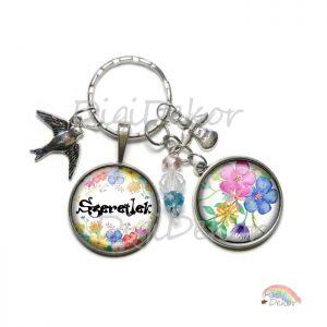 Tarka, akvarell stílusú virágokkal díszített tavaszi kulcstartó.